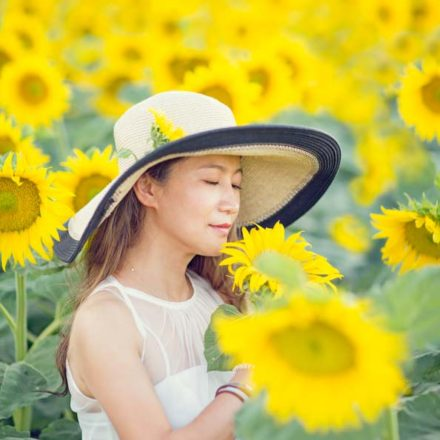 Lady at blossoming sunflower field